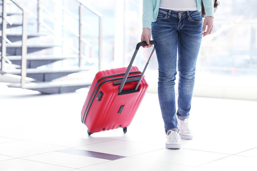 luggage, backpacks, proper lifting, back pain, neck pain