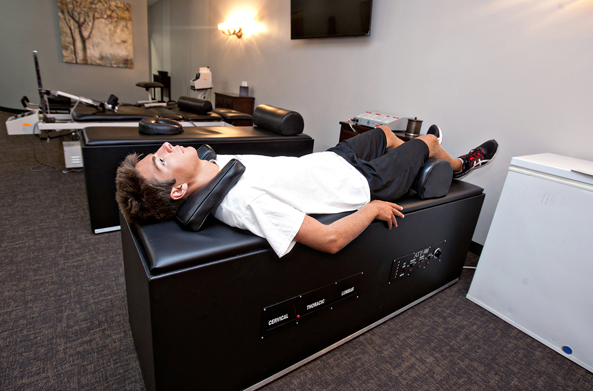 electrical muscle stimulation, intersegmental traction, chiropractor the colony tx
